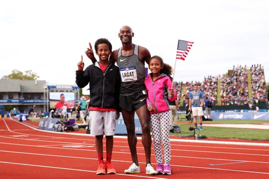Bernard Lagat poses for a picture with his daughter Gianna and son Miika after winning the 5,000-meter race at the 2016 U.S. Olympic Track Trials to qualify for his fifth Olympics.