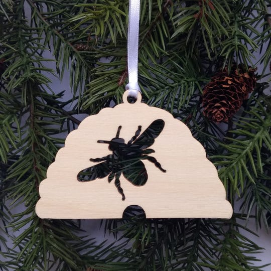 Yvonne Laube's laser-cut wood ornaments feature bees and animals.