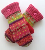 Artisan Sharon Emmett repurposes cashmere sweaters into cozy mittens.