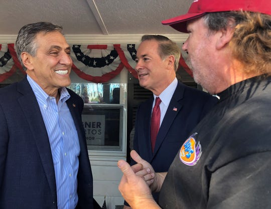 Dr. John Joyce, center, won Pennsylvania's 13th District seat in Congress. U.S. Rep. Lou Barletta, left, was not as successful in his bid for the Senate. They were photographed together at the Franklin County GOP's Get Out the Vote Rally on Oct. 30, 2018.