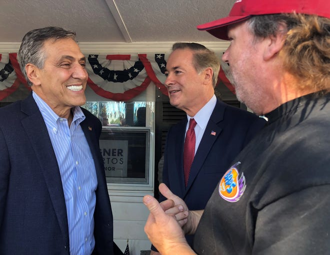 U.S. Rep. Lou Barletta (left) talks with an attendee (right) at his Get Out the Vote rally at the county's GOP headquarters on Philadelphia Avenue Tuesday afternoon. Also pictured: Dr. John Joyce (middle), who is running for U.S. Rep. Bill Shuster's seat in the 13th Congressional District.