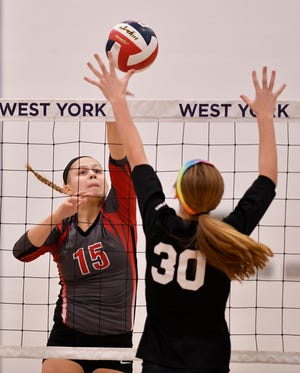 Dover's Abby Diehl hits the ball past Natalie Saxton of York Suburban during District 3 Class 3-A volleyball, Tuesday, October 30, 2018. John A. Pavoncello photo