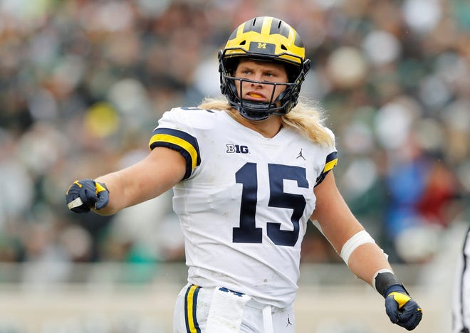 Michigan defensive lineman Chase Winovich reacts after a play during the first half of an NCAA college football game against Michigan State , Saturday, Oct. 20, 2018, in East Lansing, Mich. (AP Photo/Carlos Osorio)