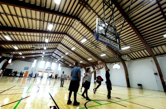 Basketball is played during an open gym session at the revitalized Voni Grimes Gym in York City after a ribbon cutting ceremony, Tuesday, Oct. 30, 2018, marked the completion of a multi-year project at the community gym. Bill Kalina photo