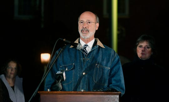 Governor Tom Wolf addresses a crowd of hundreds as they gather to show their support for the Jewish community during a Vigil Against Hate at York City Hall, Monday, October 29, 2018. 