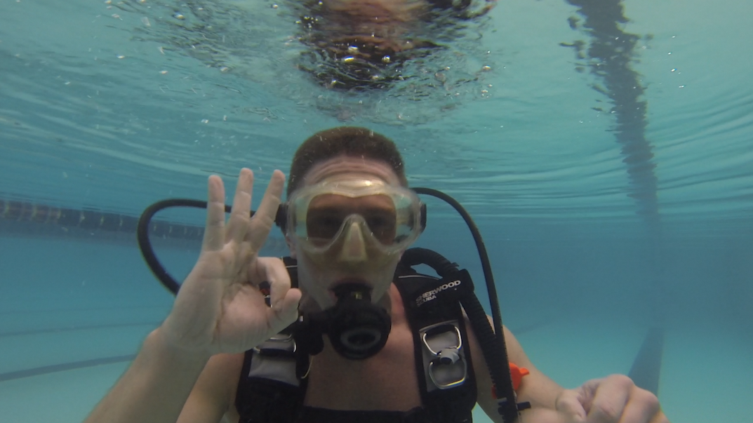 """YDR reporter John Buffone gives the """"OK"""" symbol during his first scuba diving course."""
