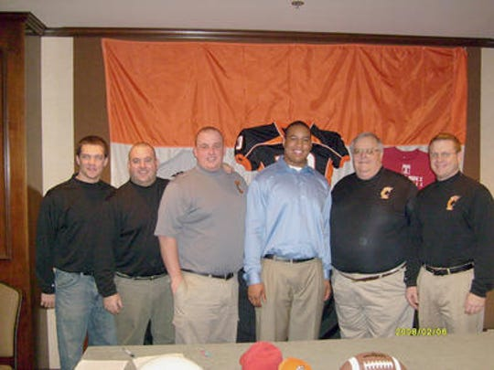 York High coach Russ Stoner (second from left) coached under Brad Livingston (second from right) for 16 years. The two are pictured here in 2008 with former Central York lineman Wayne Tribue (middle right), who was committing to Temple University. Current York High offensive coordinator Matt Baker (far right) is also pictured.