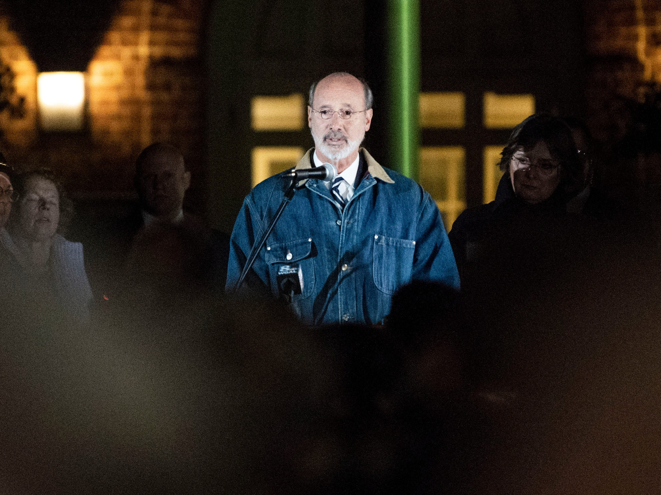 Gov. Tom Wolf speaks  Frances Wolfduring a candlelight vigil in front of city hall while First Lady Frances Wolf looks on, Monday, Oct. 29, 2018. Hundreds of people gathered for the 'York Vigil against Hate,' mourning the 11 dead from the weekend shooting at Tree of Life synagogue in Pittsburgh.