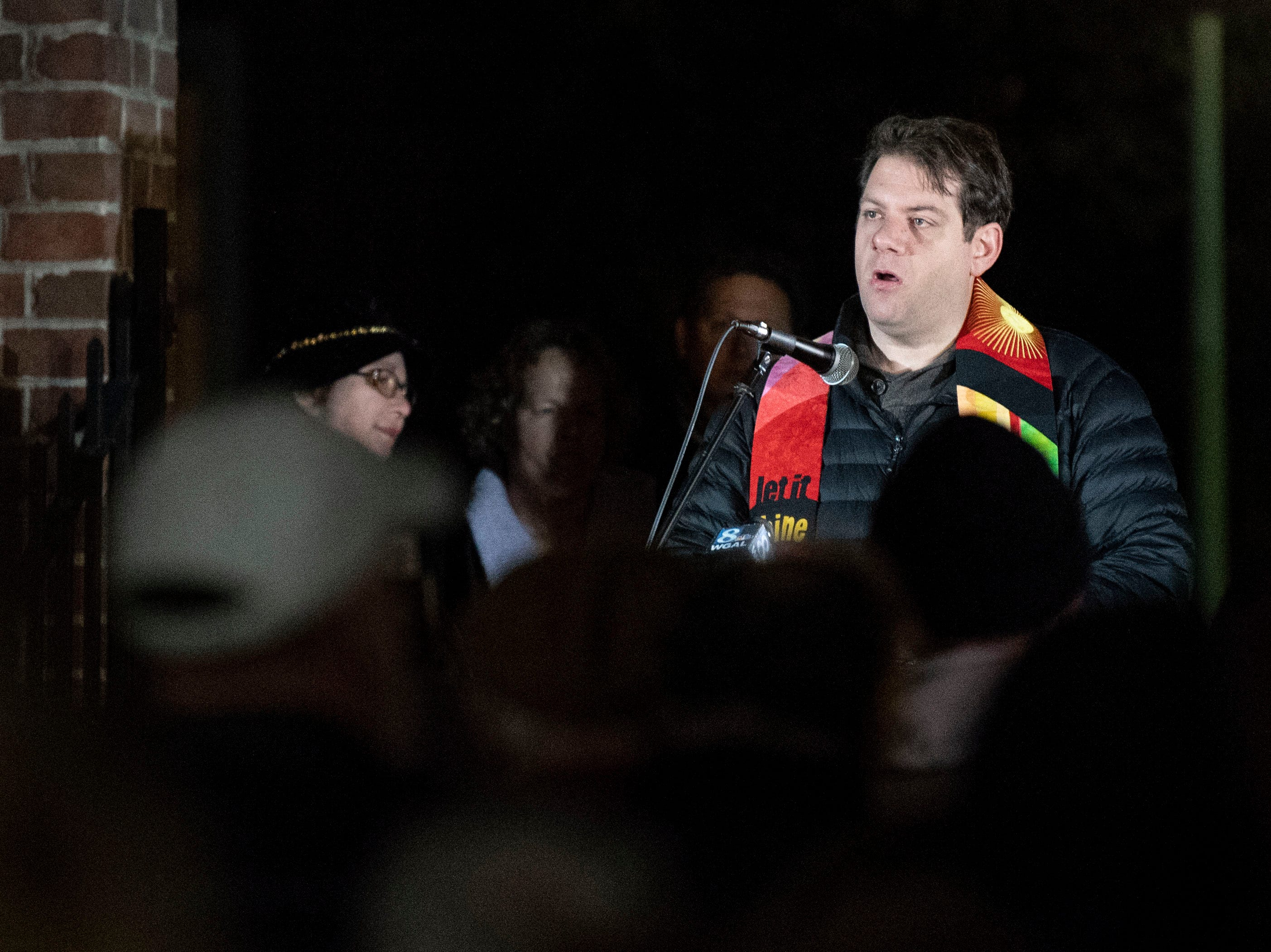 Reverand Christopher Rodkey, of St. Paul United Church of Christ, in Dallastown, speaks during a candlelight vigil in front of city hall on Monday, Oct. 29, 2018. Hundreds of people gathered for the 'York Vigil against Hate,' mourning the 11 dead from the weekend shooting at Tree of Life synagogue in Pittsburgh.