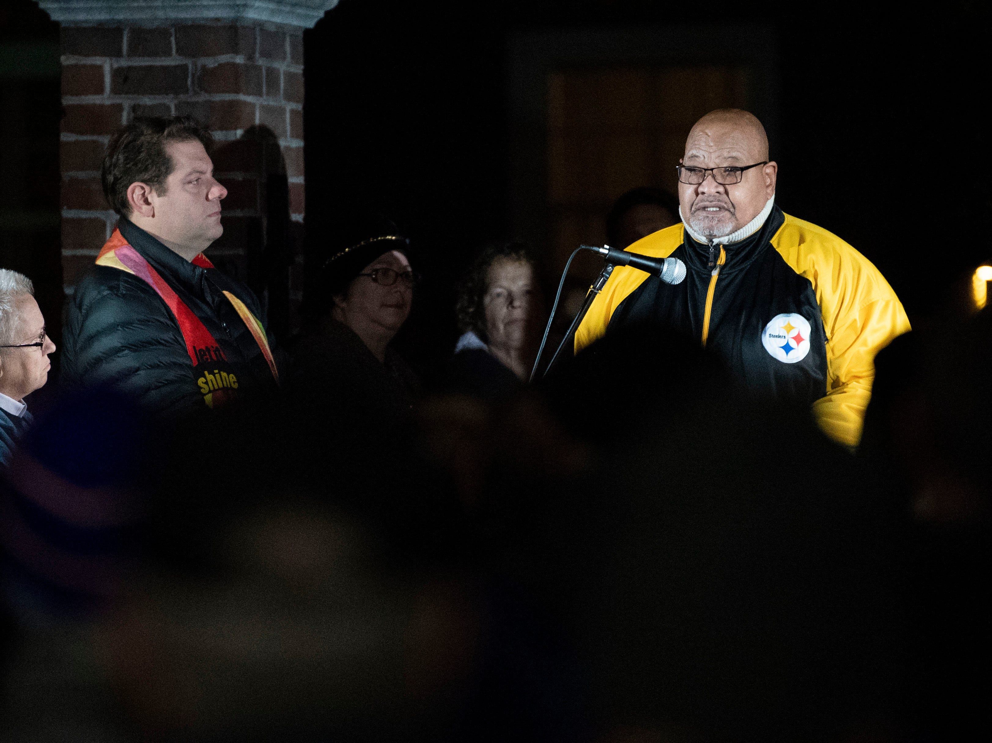 Pastor Bill Kerney, the president of the Black Ministers Association, speaks during a candlelight vigil in front of city hall on Monday, Oct. 29, 2018. Hundreds of people gathered for the 'York Vigil against Hate,' mourning the 11 dead from the weekend shooting at Tree of Life synagogue in Pittsburgh.