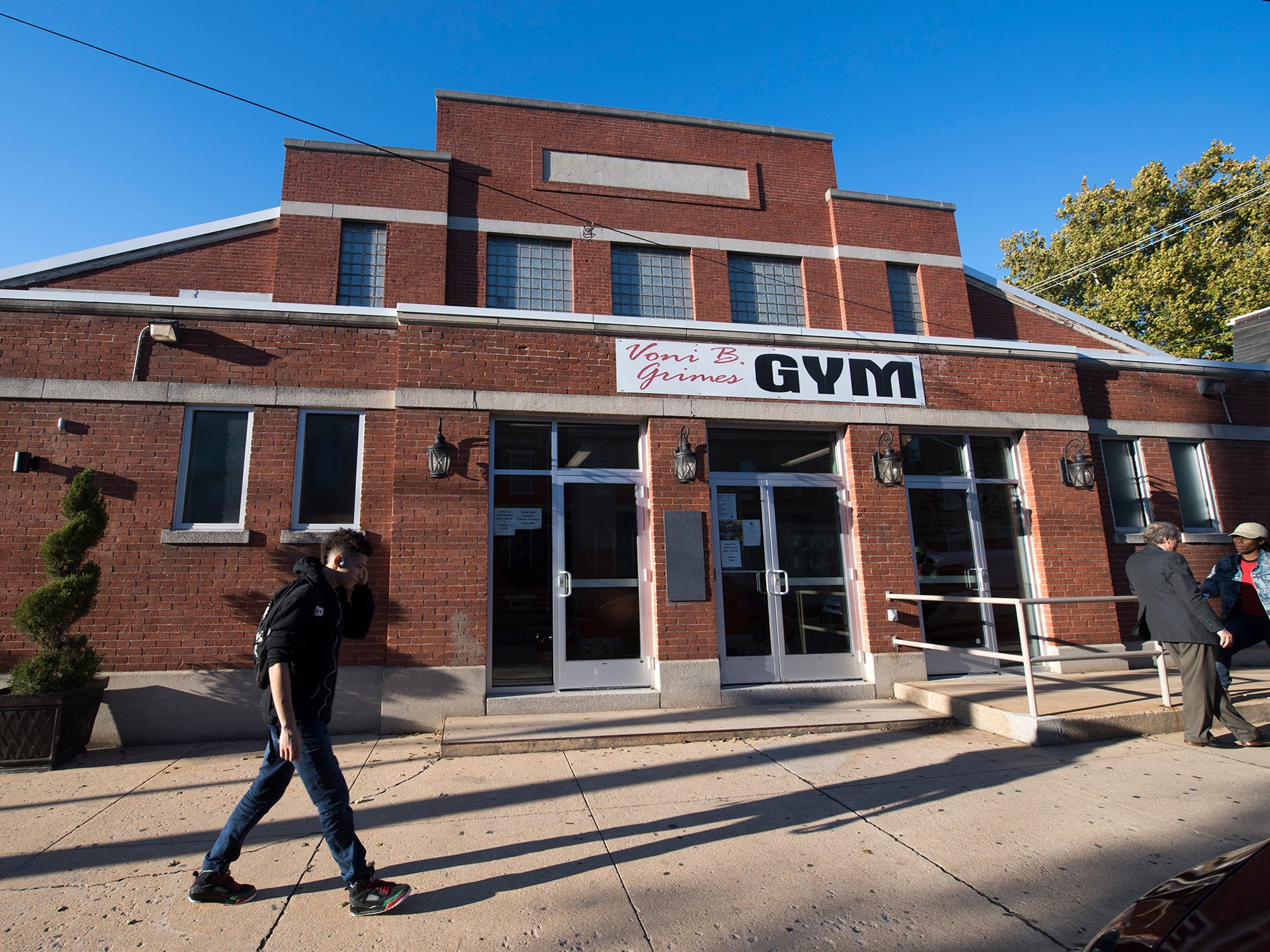 People walk outside of Voni Grimes Gym in York Tuesday. New glass doors replaced old solid doors that were hard to open. ADA accessibility was part of the renovations
