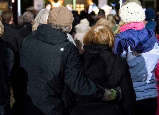 A couple embraces during a candlelight vigil in front of city hall on Monday, Oct. 29, 2018. Hundreds of people gathered for the 'York Vigil against Hate,' mourning the 11 dead from the weekend shooting at Tree of Life synagogue in Pittsburgh.