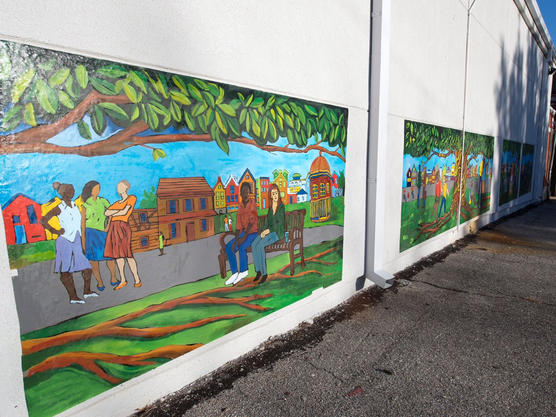 A mural on a restored and painted exterior wall of Voni Grimes gym was part of the renovation work.