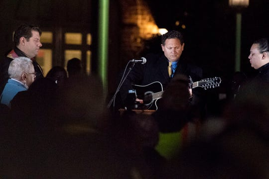 Rabbi Jeffrey Astrachan, of Temple Beth Israel, plays guitar and sings during a candlelight vigil in front of city hall on Monday, Oct. 29, 2018. Hundreds of people gathered for the 'York Vigil against Hate,' mourning the 11 dead from the weekend shooting at Tree of Life synagogue in Pittsburgh.