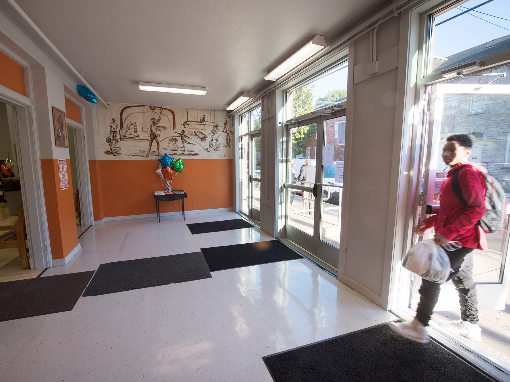 New glass doors replaced old solid ones that were hard to open at the front entrance to Voni Grimes Gym.