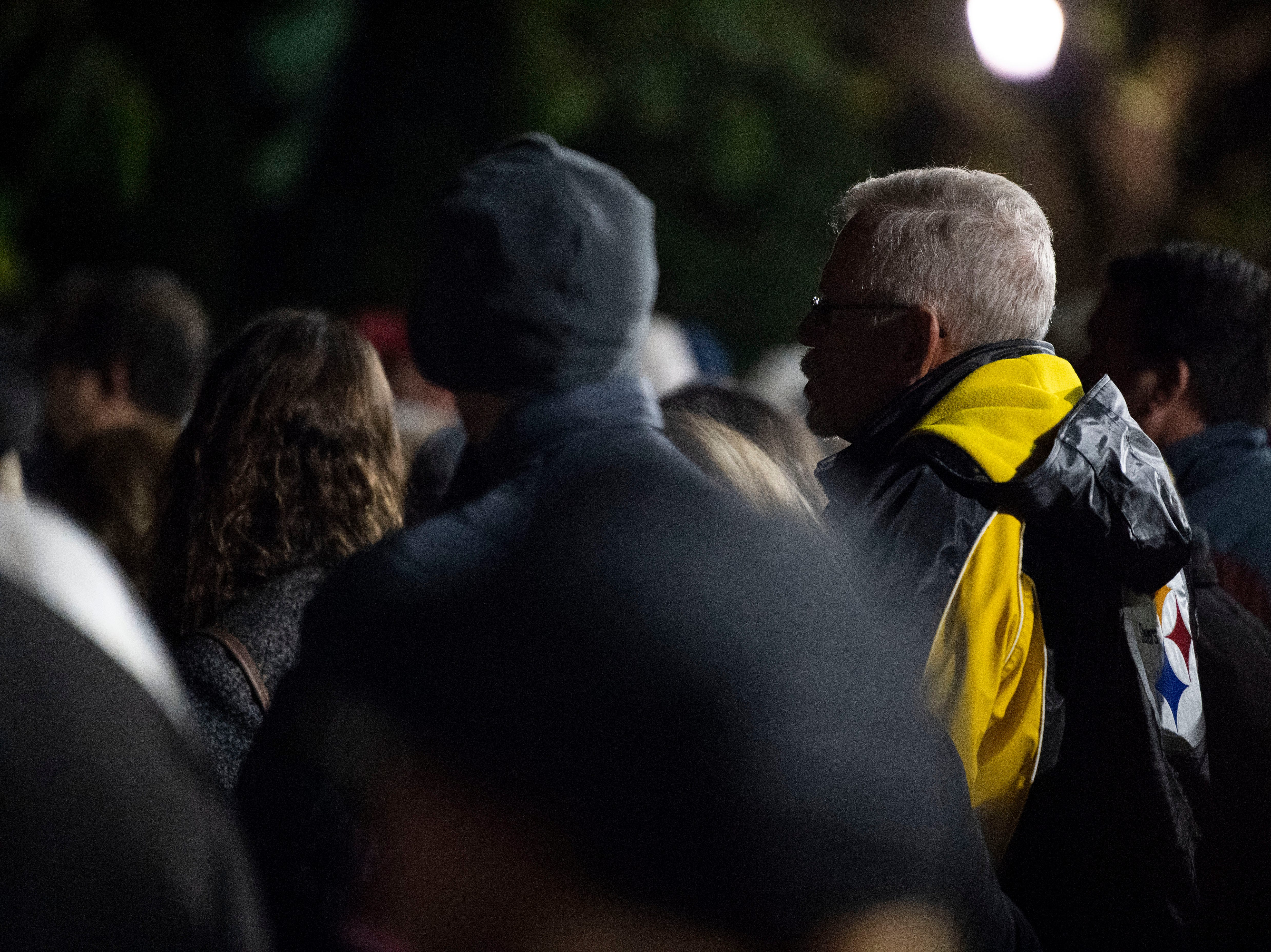 People in attendance look on during a candlelight vigil in front of city hall on Monday, Oct. 29, 2018. Hundreds of people gathered for the 'York Vigil against Hate,' mourning the 11 dead from the weekend shooting at Tree of Life synagogue in Pittsburgh.