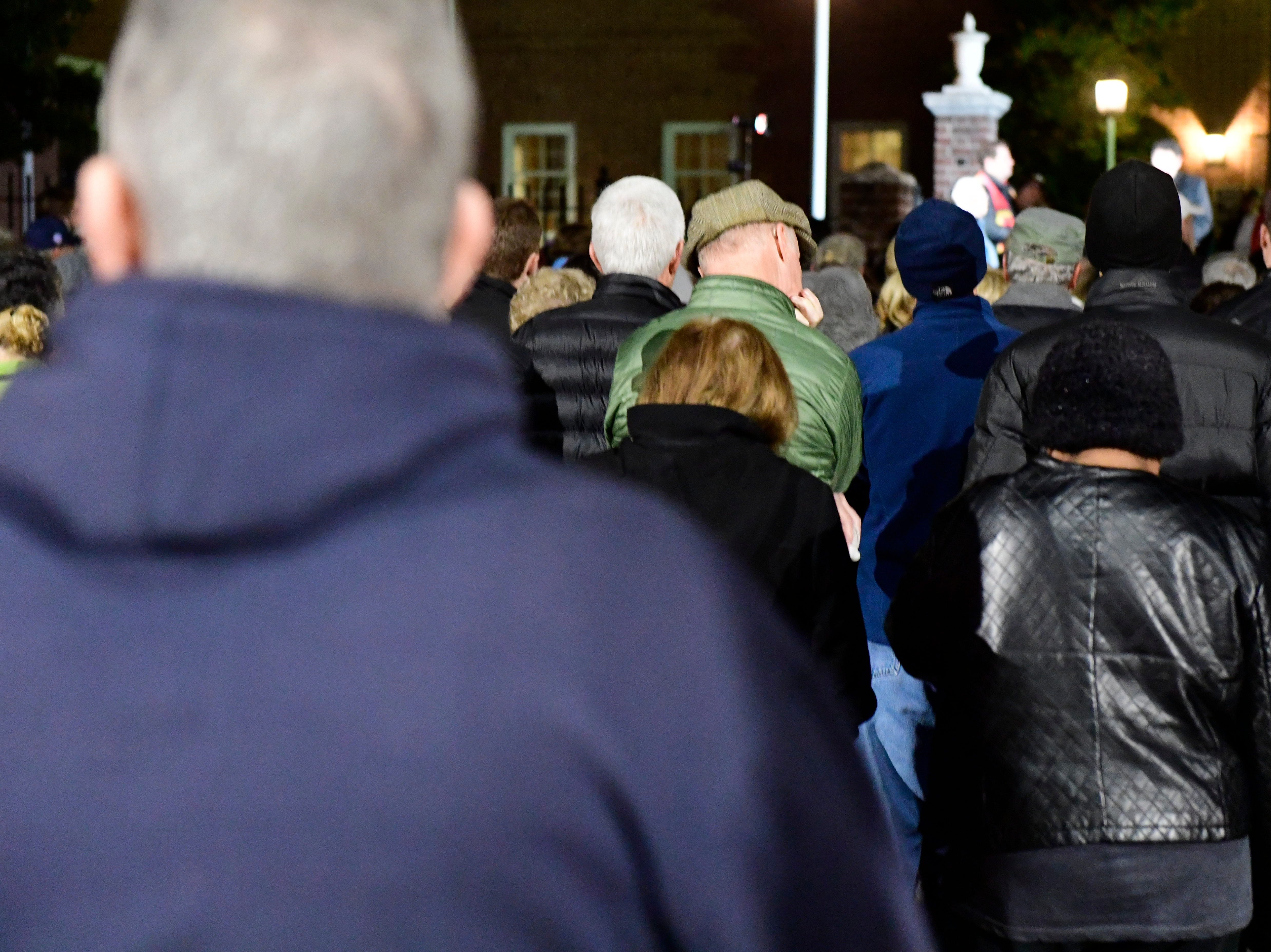People watch and listen as Rabbi Jeffrey Astrachan, of Temple Beth Israel, speaks during a candlelight vigil in front of city hall on Monday, Oct. 29, 2018. Hundreds of people gathered for the 'York Vigil against Hate,' mourning the 11 dead from the weekend shooting at Tree of Life synagogue in Pittsburgh.