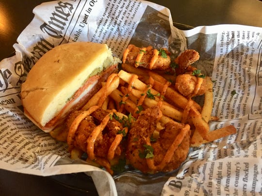 A half muffuletta joins fried shrimp striped with spicy rémoulade at Rue Bourbon in Midtown Reno.