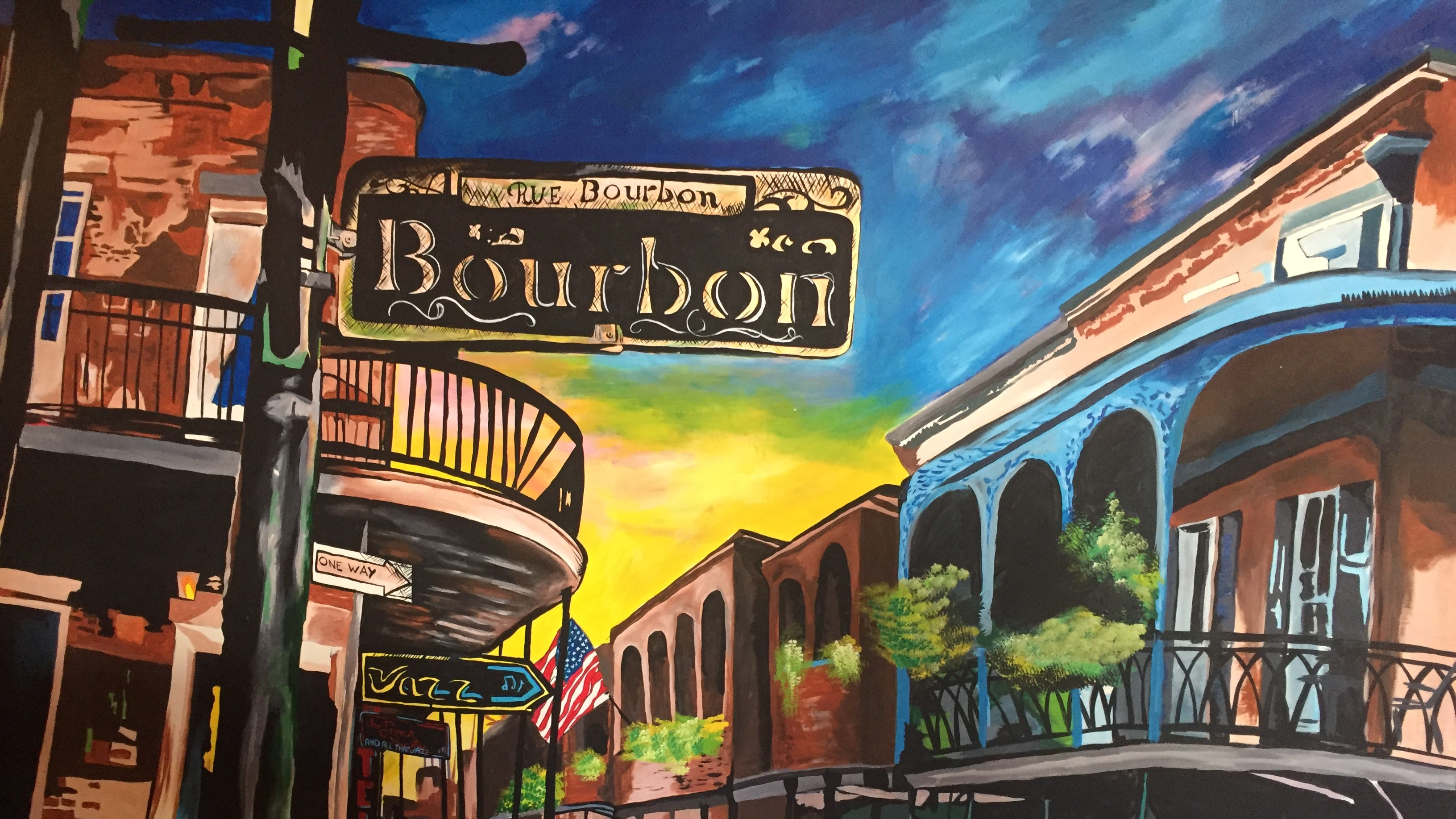 At the new Rue Bourbon restaurant in Midtown Reno, a mural of Bourbon Street in New Orleans, the restaurant's namesake, brightens the bar and dining room. The restaurant offers a small menu of New Orleans standards.