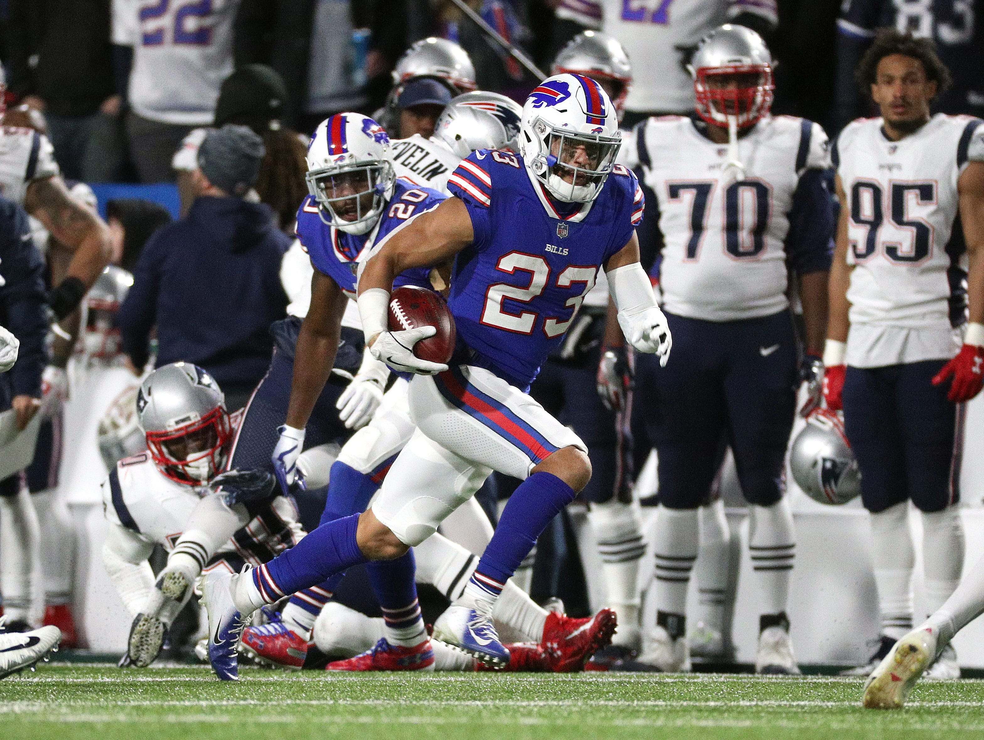 Bills Micah Hyde returns a punt against the Patriots.