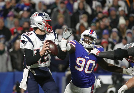 Patriots quarterback Tom Brady os pressured by Bills Shaq Lawson.