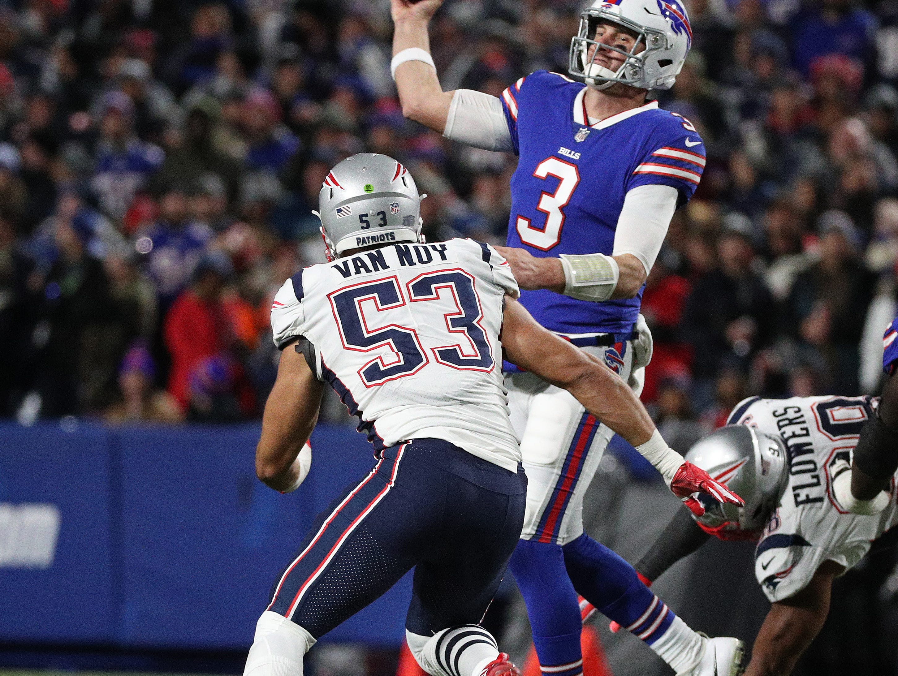 Bills quarterback Derek Anderson gets rid of the ball under pressure by Patriots Kyle Van Noy.