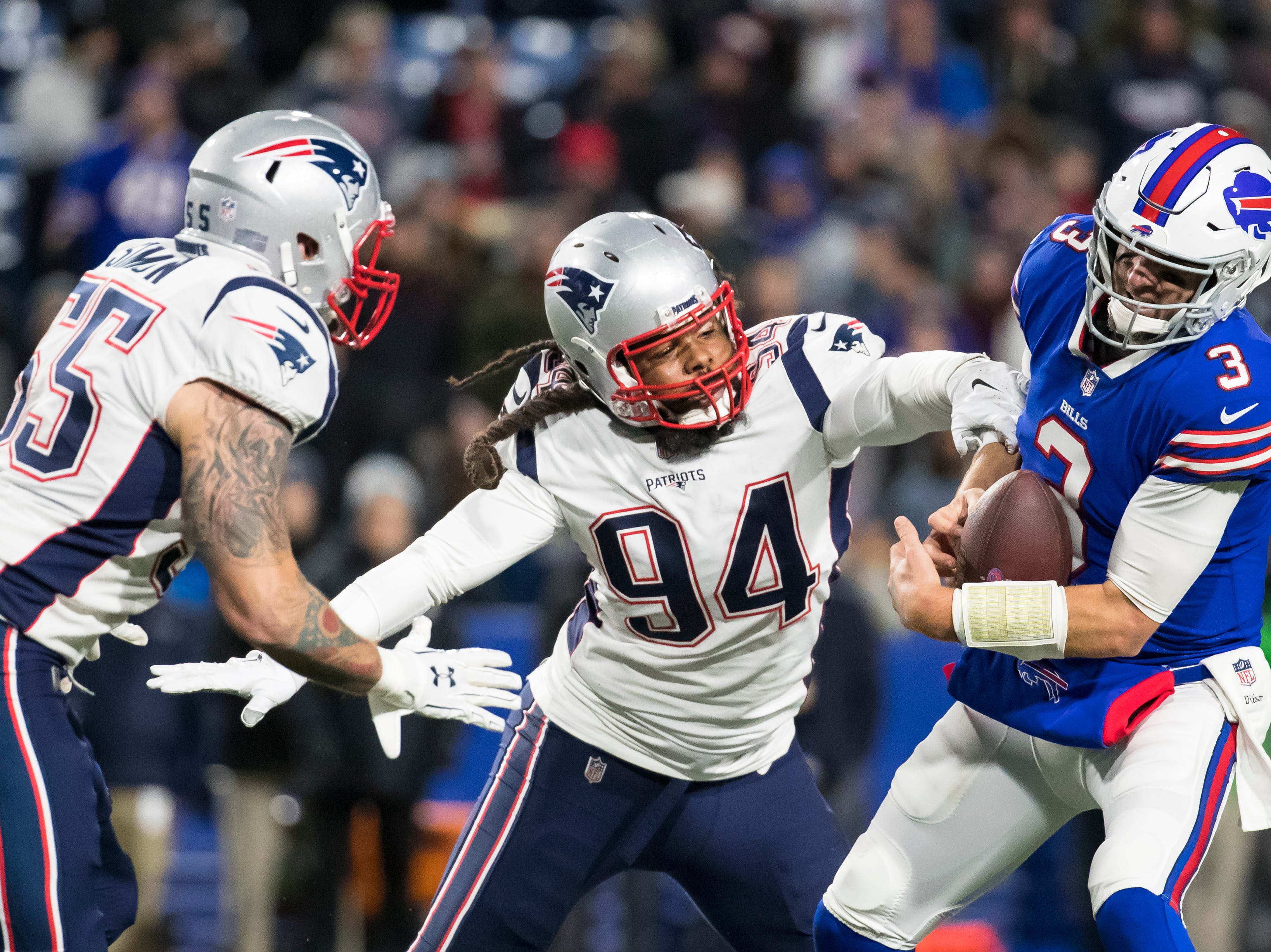 ORCHARD PARK, NY - OCTOBER 29:  Derek Anderson #3 of the Buffalo Bills is sacked by Adrian Clayborn #94 and John Simon #55 of the New England Patriots during the fourth quarter at New Era Field on October 29, 2018 in Orchard Park, New York. New England defeats Buffalo 25-6.  (Photo by Brett Carlsen/Getty Images)