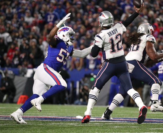 Jerry Hughes pressures Patriots quarterback Tom Brady during an Oct. 29 game in Orchard Park.