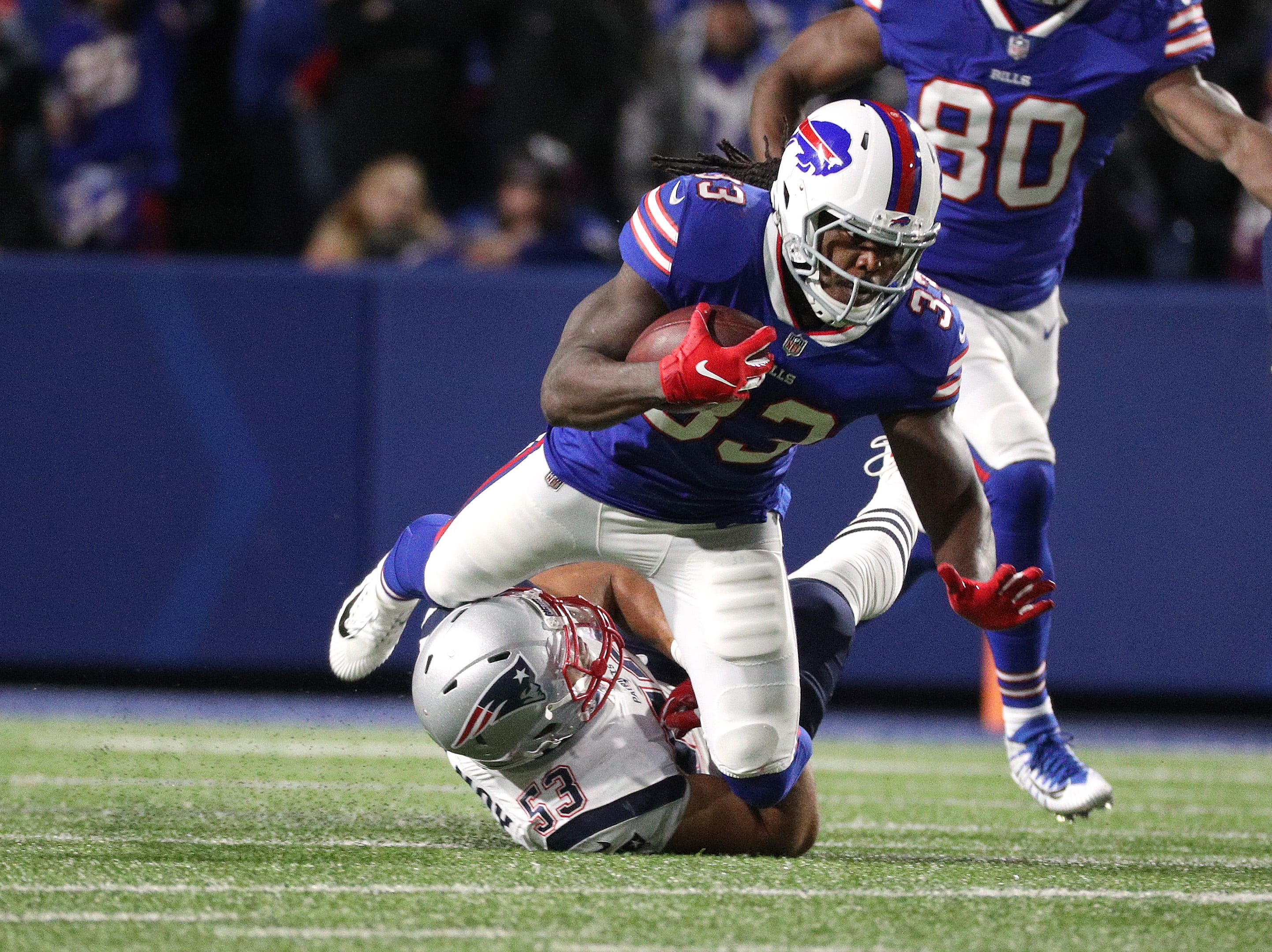 Bills running back Chris Ivory is tackled against the Patriots.