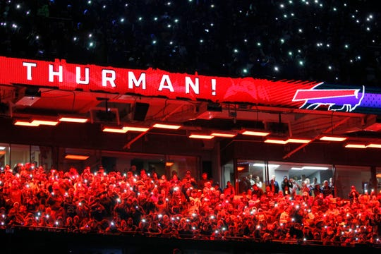 People hold up cell phones with their flashlights on during a halftime celebration retiring the number of former Buffalo Bills running back Thurman Thomas during an NFL football game against the New England Patriots, Monday, Oct. 29, 2018, in Orchard Park, N.Y. (AP Photo/Jeffrey T. Barnes)