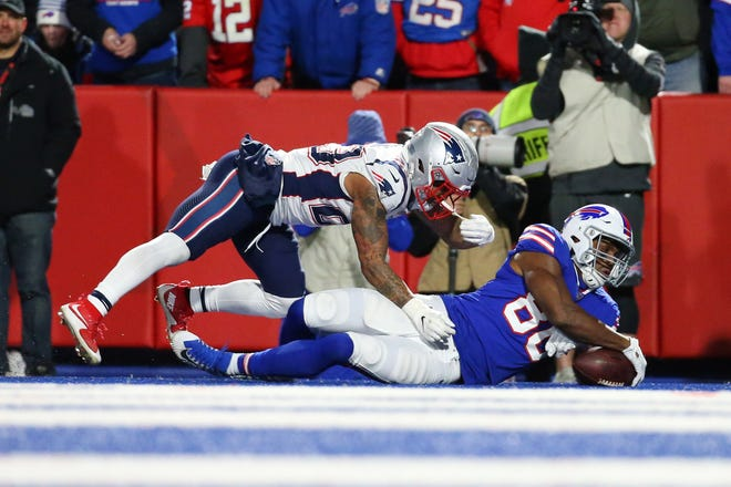 Oct 29, 2018; Orchard Park, NY, USA; Buffalo Bills tight end Jason Croom (80) drops a pass in the end zone as New England Patriots strong safety Patrick Chung (23) defends during the fourth quarter at New Era Field. Mandatory Credit: Rich Barnes-USA TODAY Sports