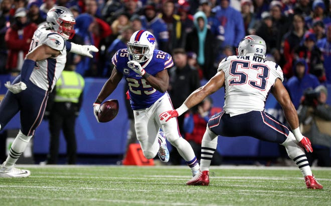 Bills running back LeSean McCoy looks for running room against Kyle Van Noy (53) and the Patriots.