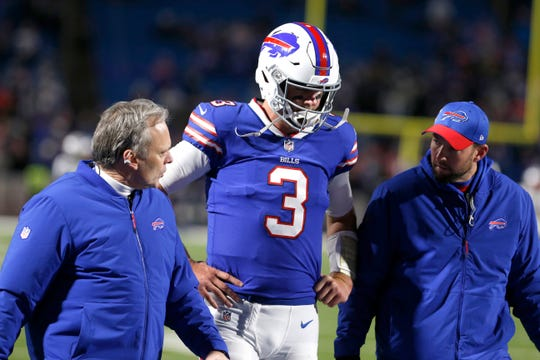 Oct 29, 2018; Orchard Park, NY, USA; Buffalo Bills quarterback Derek Anderson (3) goes off the field with trainers after getting hurt during the second half against the New England Patriots at New Era Field. Mandatory Credit: Timothy T. Ludwig-USA TODAY Sports