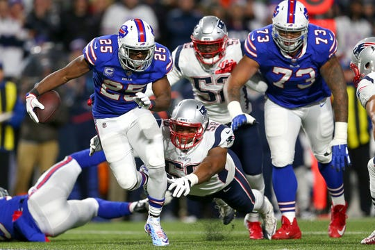 Buffalo Bills running back LeSean McCoy (25) is tripped up by New England Patriots defensive end Keionta Davis (58) during the first half of an NFL football game, Monday, Oct. 29, 2018, in Orchard Park, N.Y. (AP Photo/Jeffrey T. Barnes)