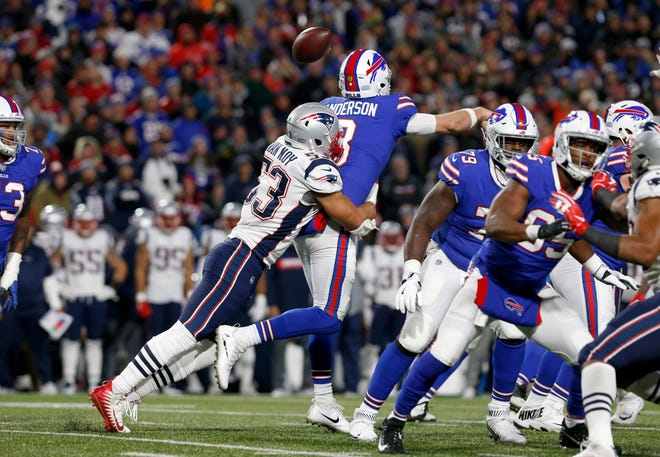 Oct 29, 2018; Orchard Park, NY, USA; New England Patriots linebacker Kyle Van Noy (53) hits Buffalo Bills quarterback Derek Anderson (3) and causes a fumble during the second half at New Era Field. Mandatory Credit: Timothy T. Ludwig-USA TODAY Sports