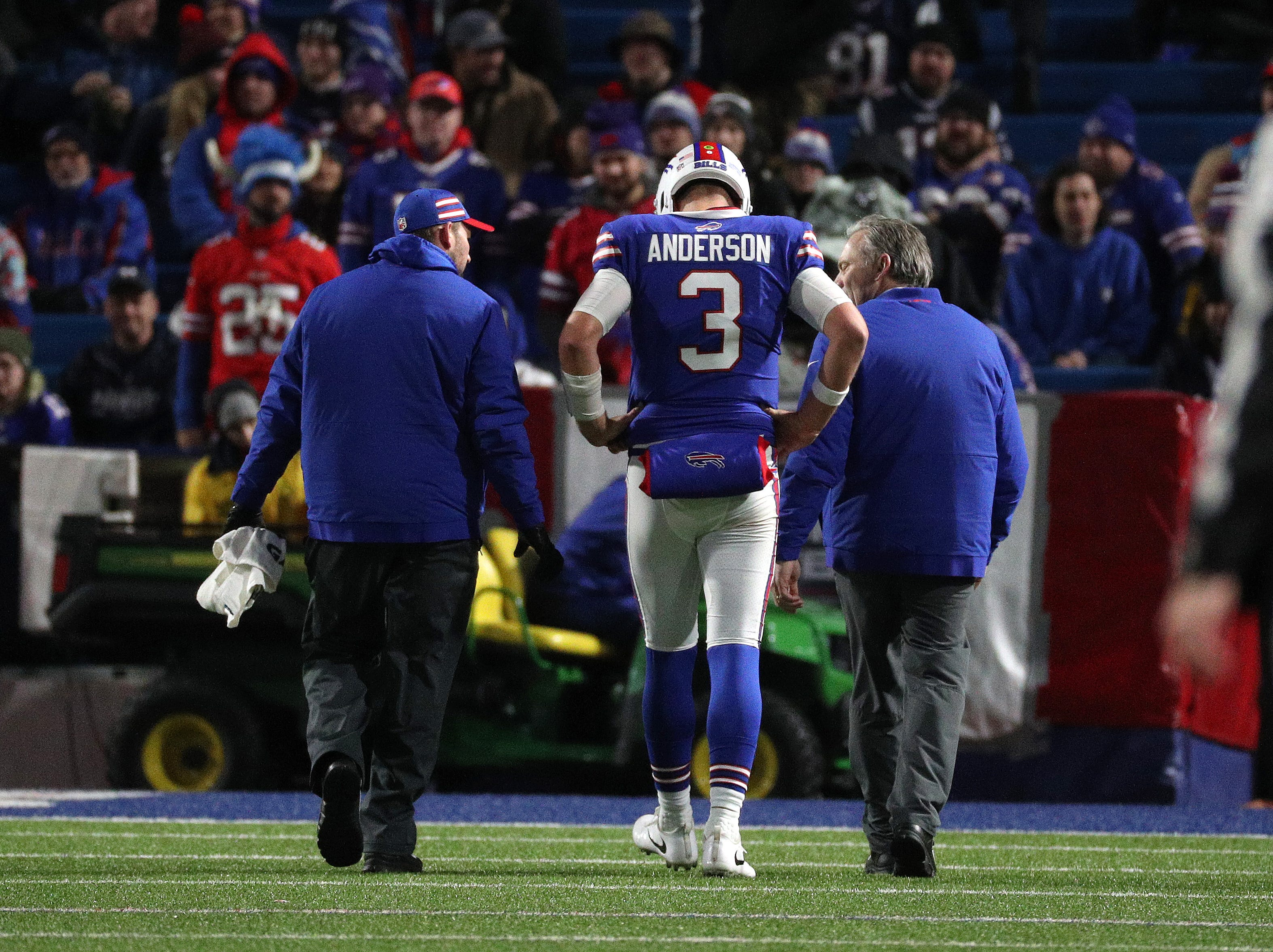 Bills quarterback Derek Anderson leaves the field after being sacked and injured.  The Patriots beat the Bills 25-6.