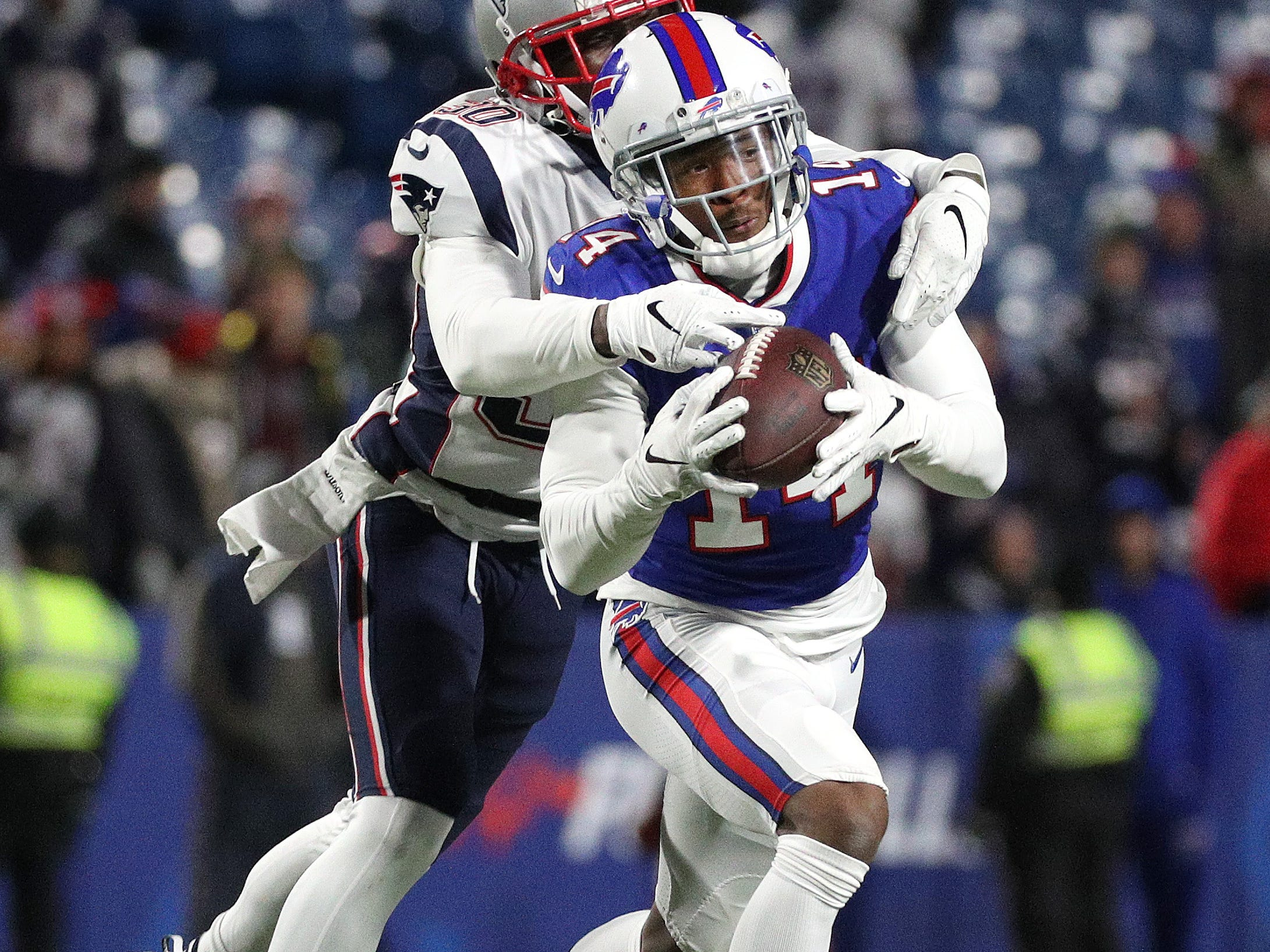 Bills receiver Ray-Ray McCloud lll catches a pass behind Patriots Jason McCourty.