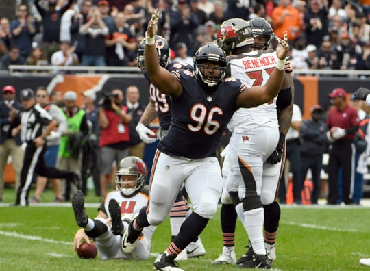 Chicago Bears defensive end Akiem Hicks (96) celebrates after sacking Tampa Bay Buccaneers quarterback Ryan Fitzpatrick (14). Hicks has three sacks and leads Bears No. 10 defense against Buffalo's No. 31 offense.