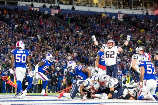 ORCHARD PARK, NY - OCTOBER 29:  James White #28 of the New England Patriots scores a running touchdown during the fourth quarter against the Buffalo Bills at New Era Field on October 29, 2018 in Orchard Park, New York. New England defeats Buffalo 25-6.  (Photo by Brett Carlsen/Getty Images)