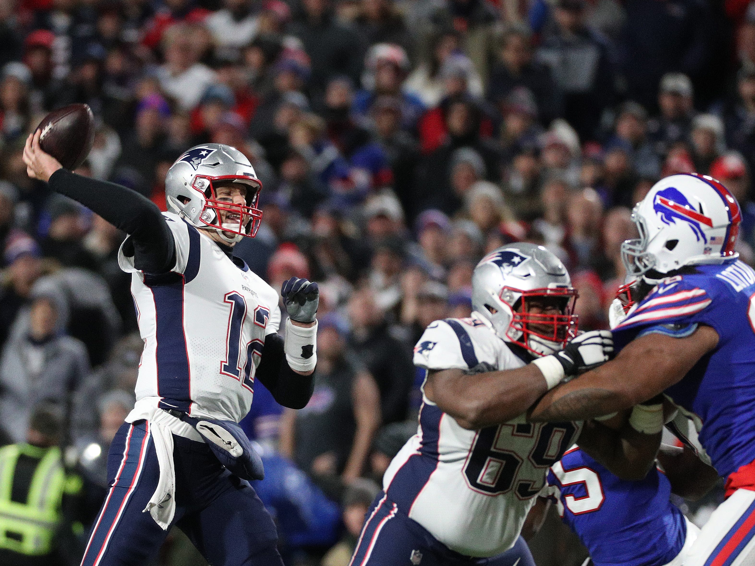 Patriots quarterback Tom Brady steps into a throw against the Bills.