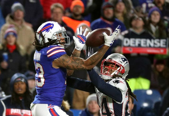 Bills receiver Kelvin Benjamin  can't hold on to this pass as he is defended by Patriots Stephon Gilmore.