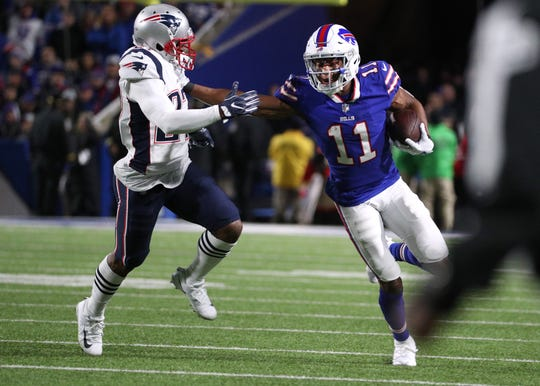 Bills receiver Zay Jones looks for yards after a catch against the Patriots.