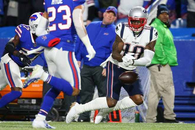 Oct 29, 2018; Orchard Park, NY, USA; New England Patriots wide receiver Josh Gordon (10) drops a pass against the Buffalo Bills during the first quarter at New Era Field. Mandatory Credit: Rich Barnes-USA TODAY Sports