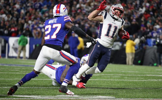 Patriots receiver Julian Edelman is tackled after a catch.