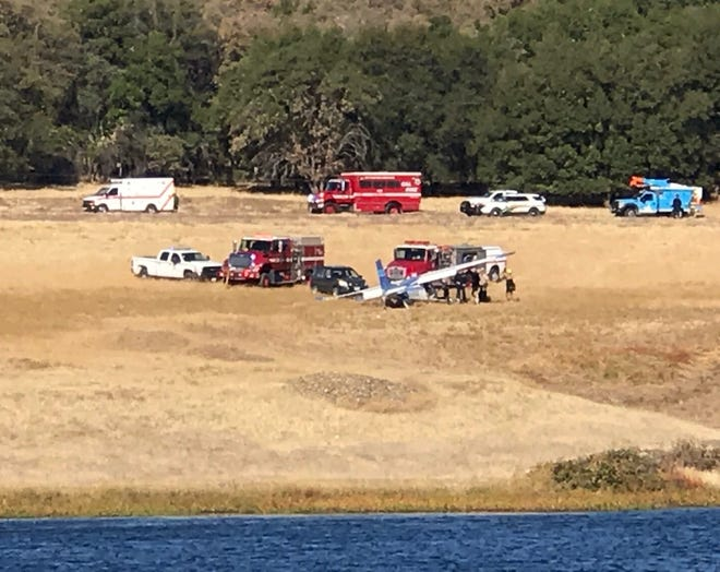 A pilot in a light plane crashed Tuesday morning at Lake California. The pilot apparently survived, suffering unspecified injuries.