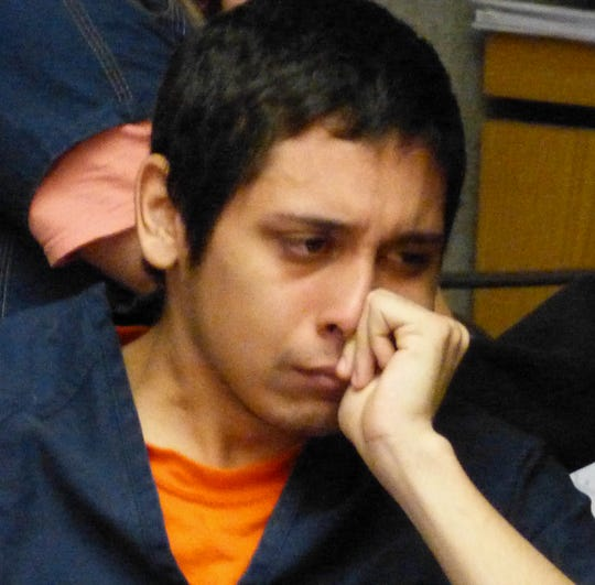 Samuel Scholfield tries to regain his composure after shedding tears at his arraignment in Shasta County Superior Court.