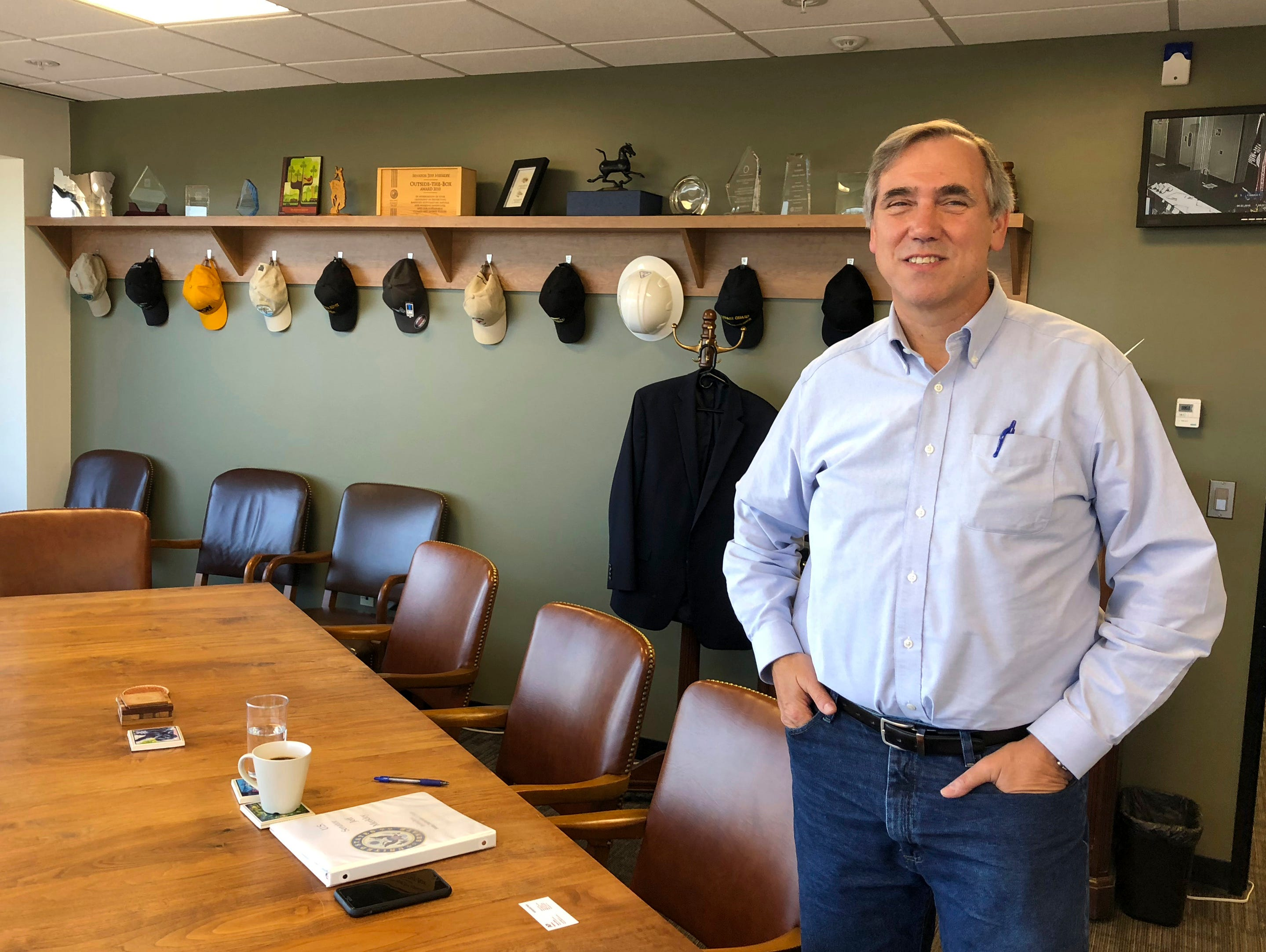 Sen Jeff Merkley, D-Ore., poses for a photo in his office in Portland, Ore., Sept. 7, 2018. Merkley, a frequent critic of President Donald Trump, is seriously considering a run for the White House.