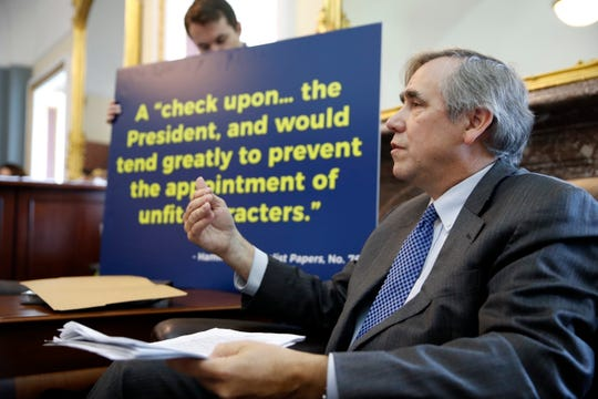 FILE - In this Sept. 26, 2018 file photo Sen. Jeff Merkley, D-Ore., talks with reporters about the nomination of Brett Kavanaugh to the Supreme Court, on Capitol Hill, in Washington. Merkley, a frequent critic of President Donald Trump, is seriously considering a run for the White House.