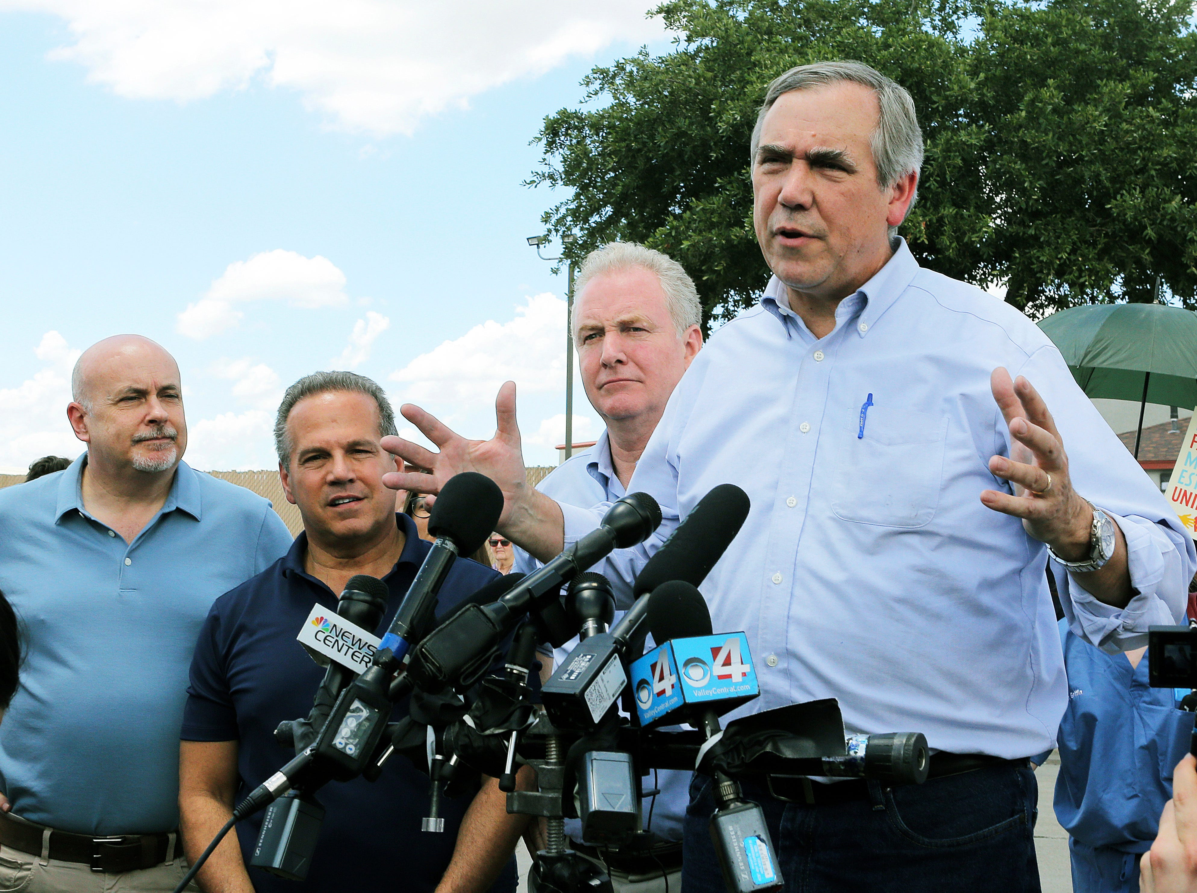 FILE - In this June 17, 2018, file photo, U.S. Sen. Jeff Merkley, D-Ore., speaks to the media, as U.S. Sen. Chris Van Hollen, center, D-Md., U.S. Rep. David Cicilline, D-R.I., and U.S. Rep. Mark Pocan, D-Wis., listen in front of the U.S. Customs and Border Protection's Rio Grande Valley Sector's Centralized Processing Center in McAllen, Texas. Merkley, a frequent critic of President Donald Trump, is seriously considering a run for the White House