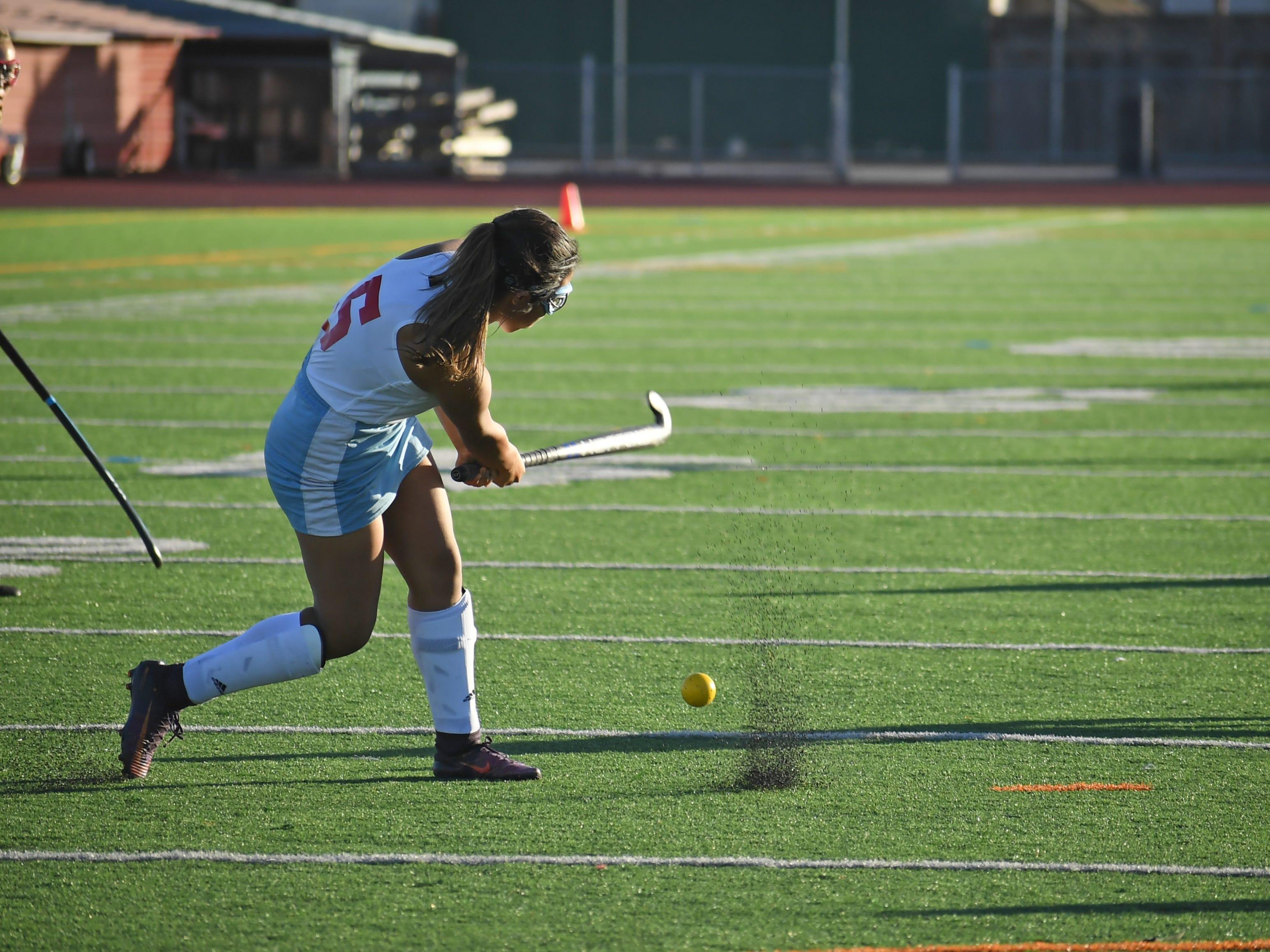 Midfielder Samantha Herrera (5) fires a shot downfield towards Natalia Cardenas.